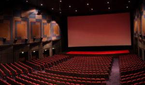 Watch a movie in a cinema hall